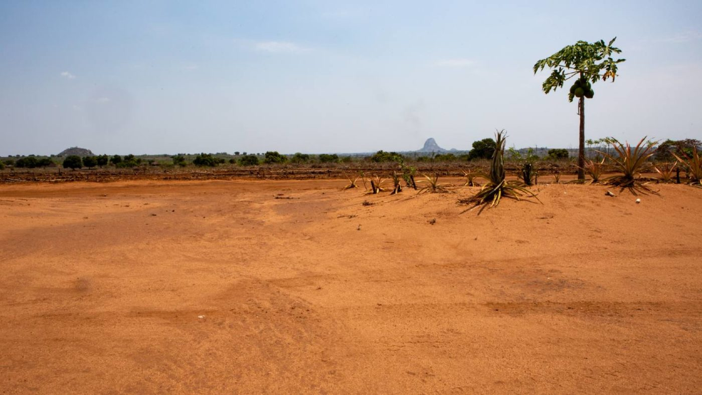 Landscape photo with mountain in the background of community in Zambezia, Mozambique.