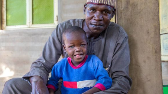 Seven-year-old Muzi together with his father