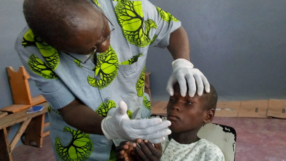a young boy at an eye health screening in Cameroon.