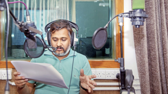 A man talking into a microphone.