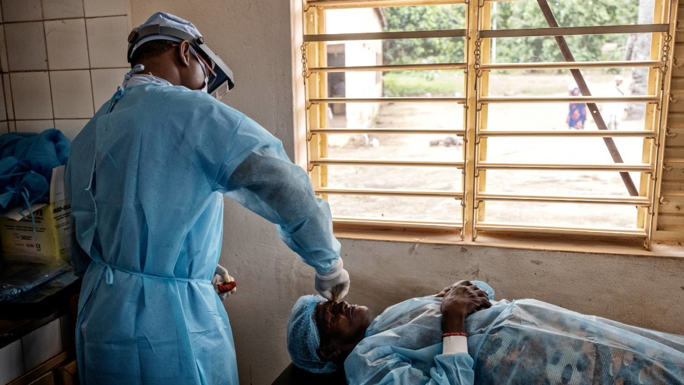 A surgeon performs trachoma surgery on a patient.