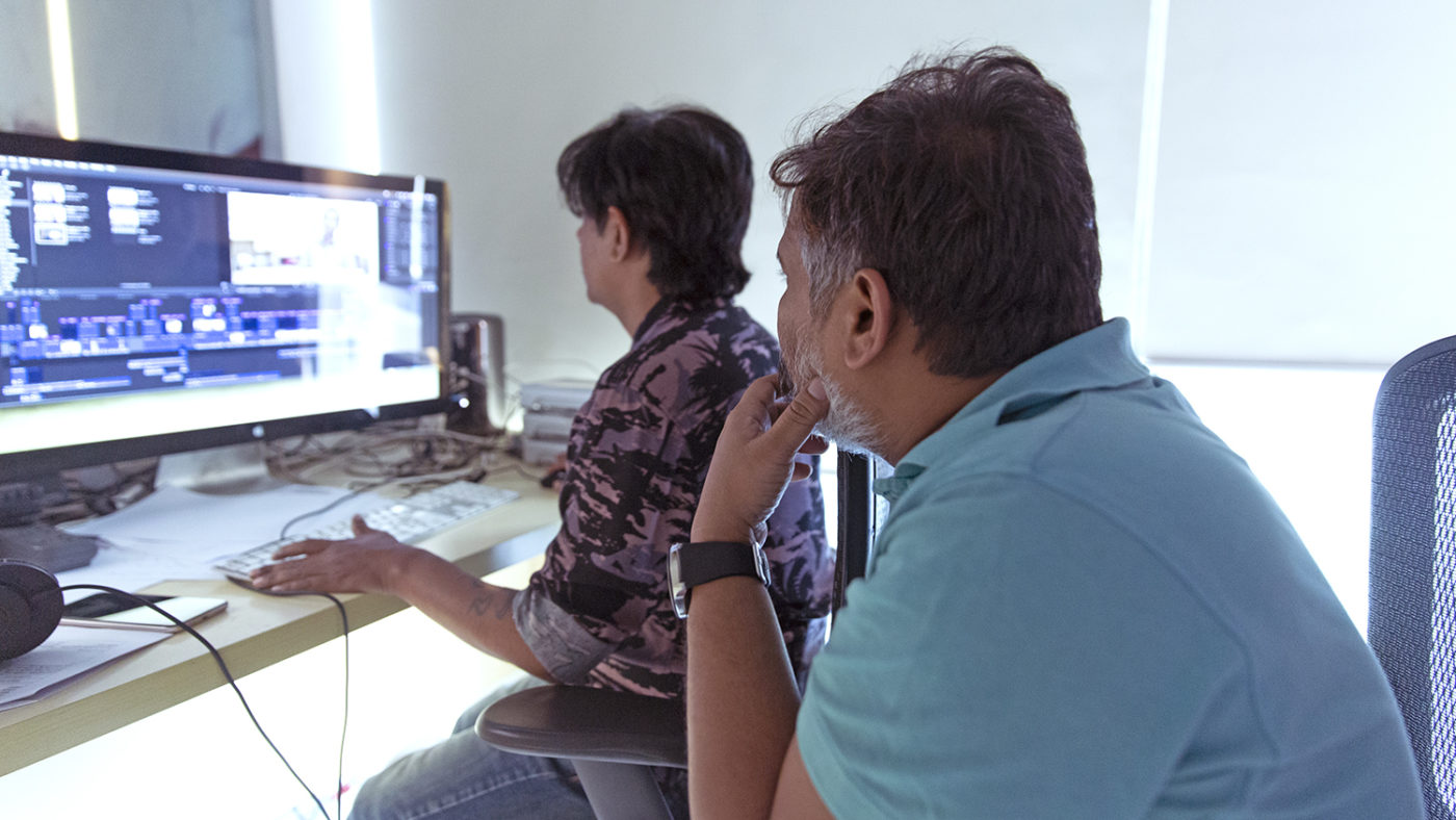 Two people looking at a computer screen.