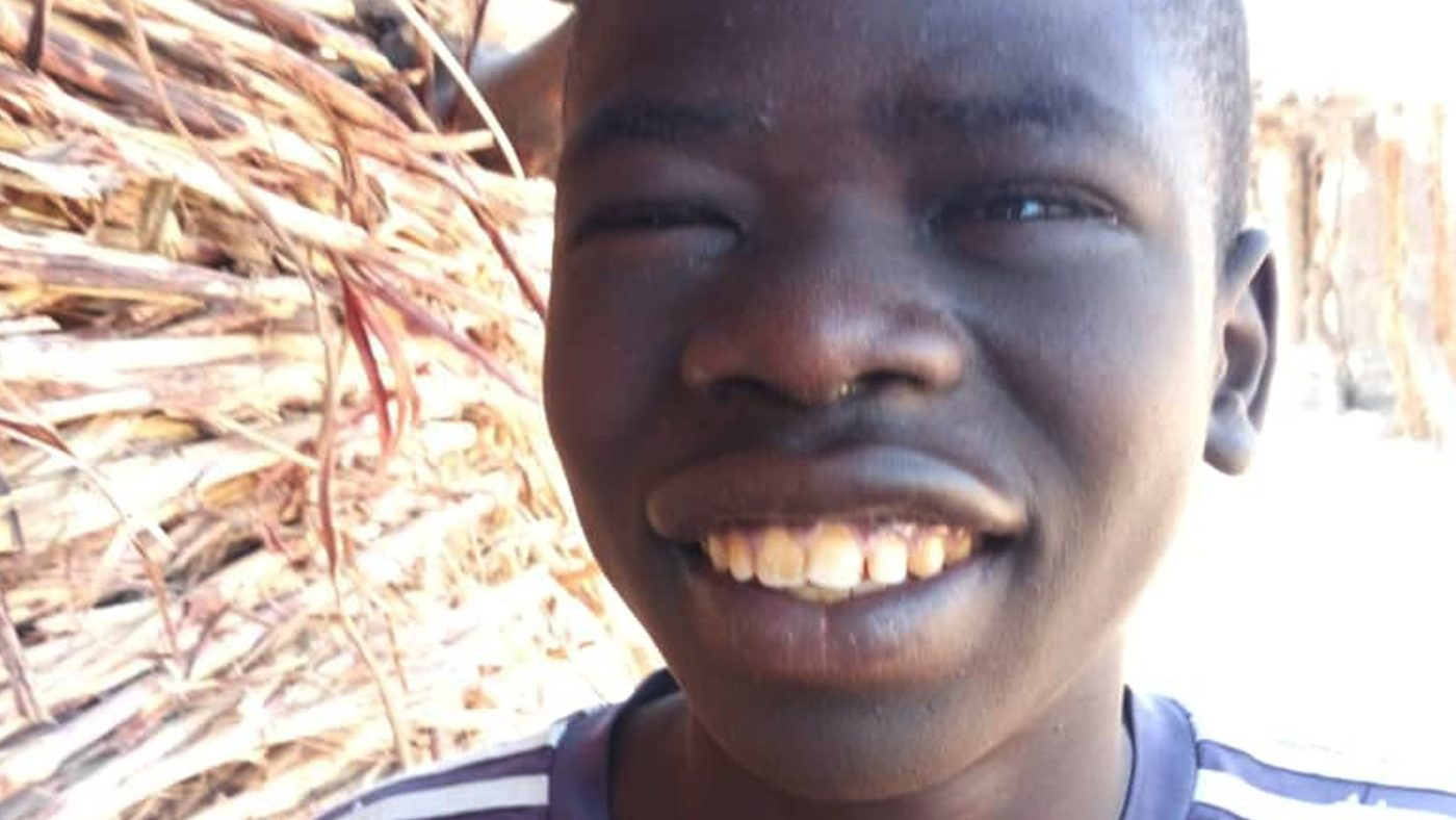 Boy smiling after a successful trichiasis surgery.