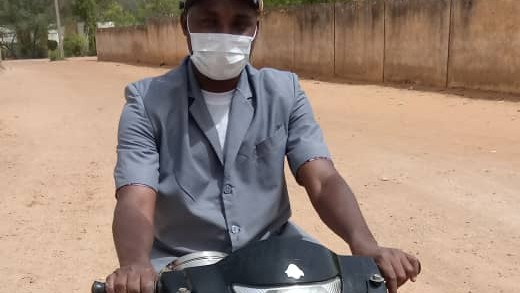 Surgeon Kabir wearing face mask on motorbike