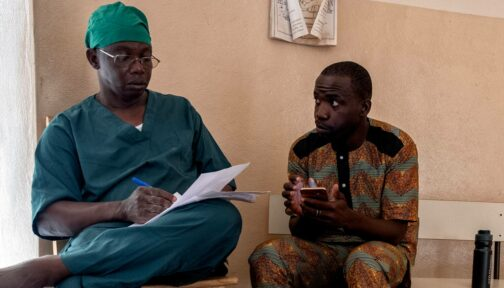 Zakari works with the surgeon to record patient data on the TT Tracker