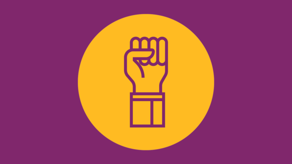 A yellow illustrated fist of solidarity on a plum background