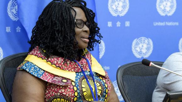 Gertrude Oforiwa Fefoame speaking into a microphone.