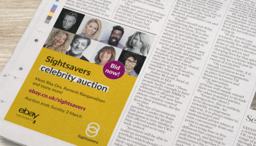 A newspaper containing a Sightsavers branded advert.