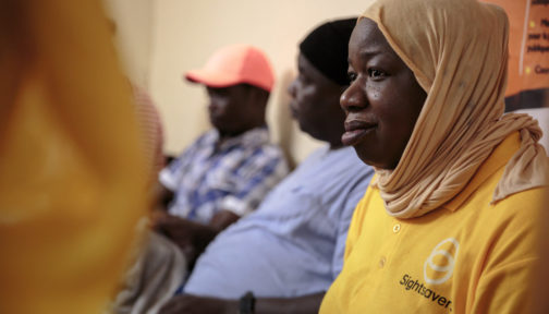A woman with a headscarf wearing a Sightsavers t-shirt.