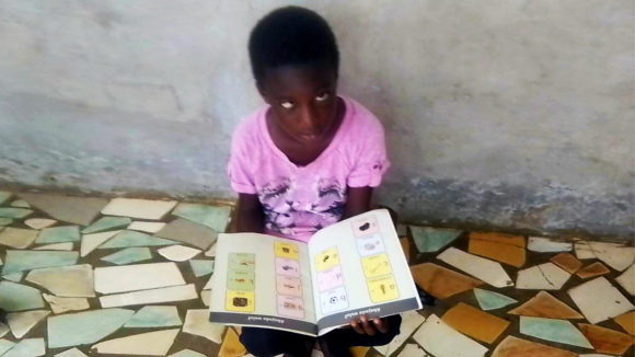 A child with a book.