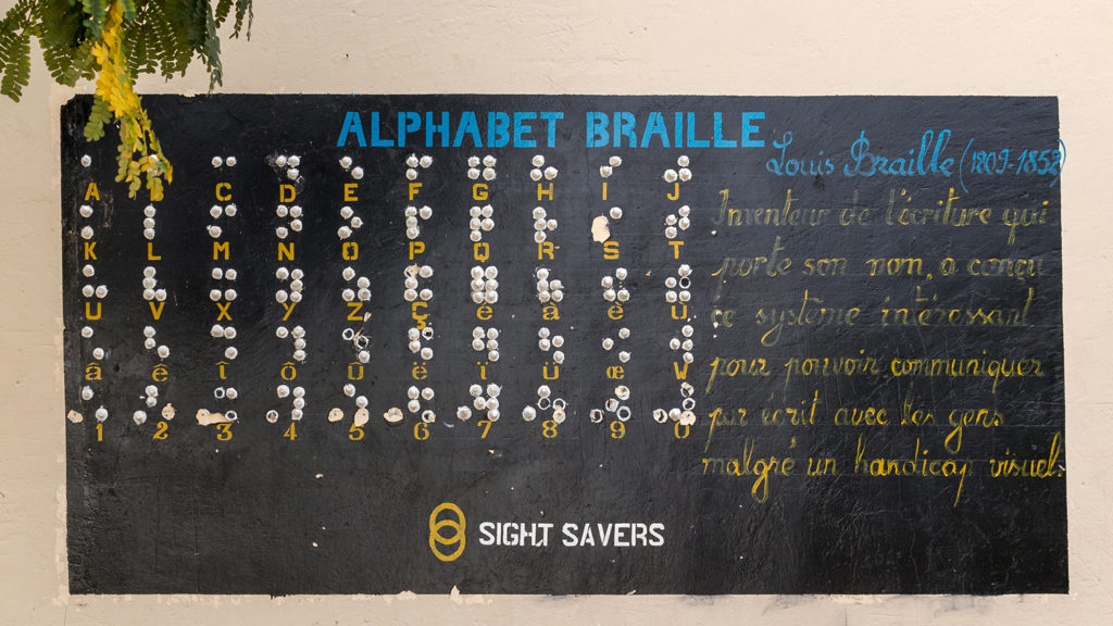 The alphabet painted onto a wall, with the braille under each letter.