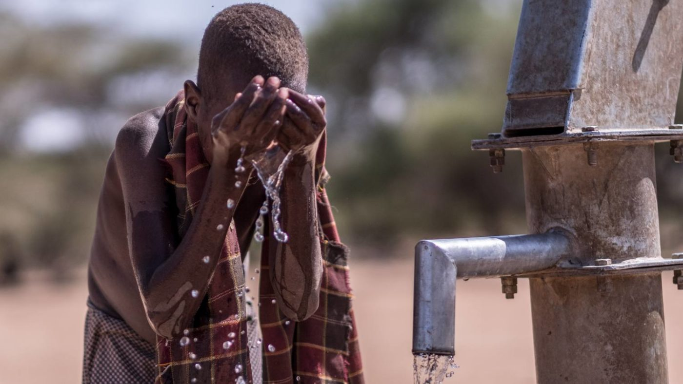 A boy washes his face at a well in Turkana, Kenya. Good hygiene is key to reducing the incidence of Trachoma and other eye conditions.