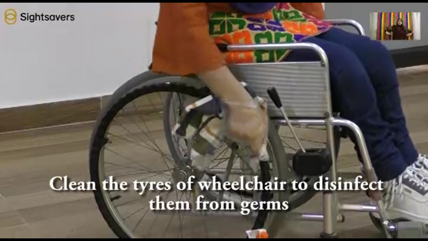 A still from a video explaining how to clean a wheelchair.