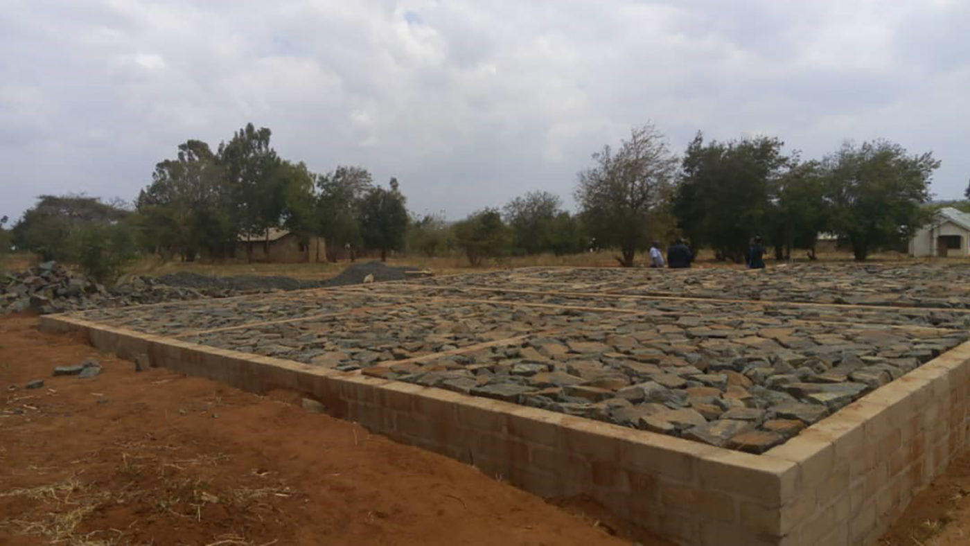 The foundations of a building begin to be laid.