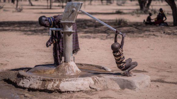 Hand washing at a water pump in rural Kenya