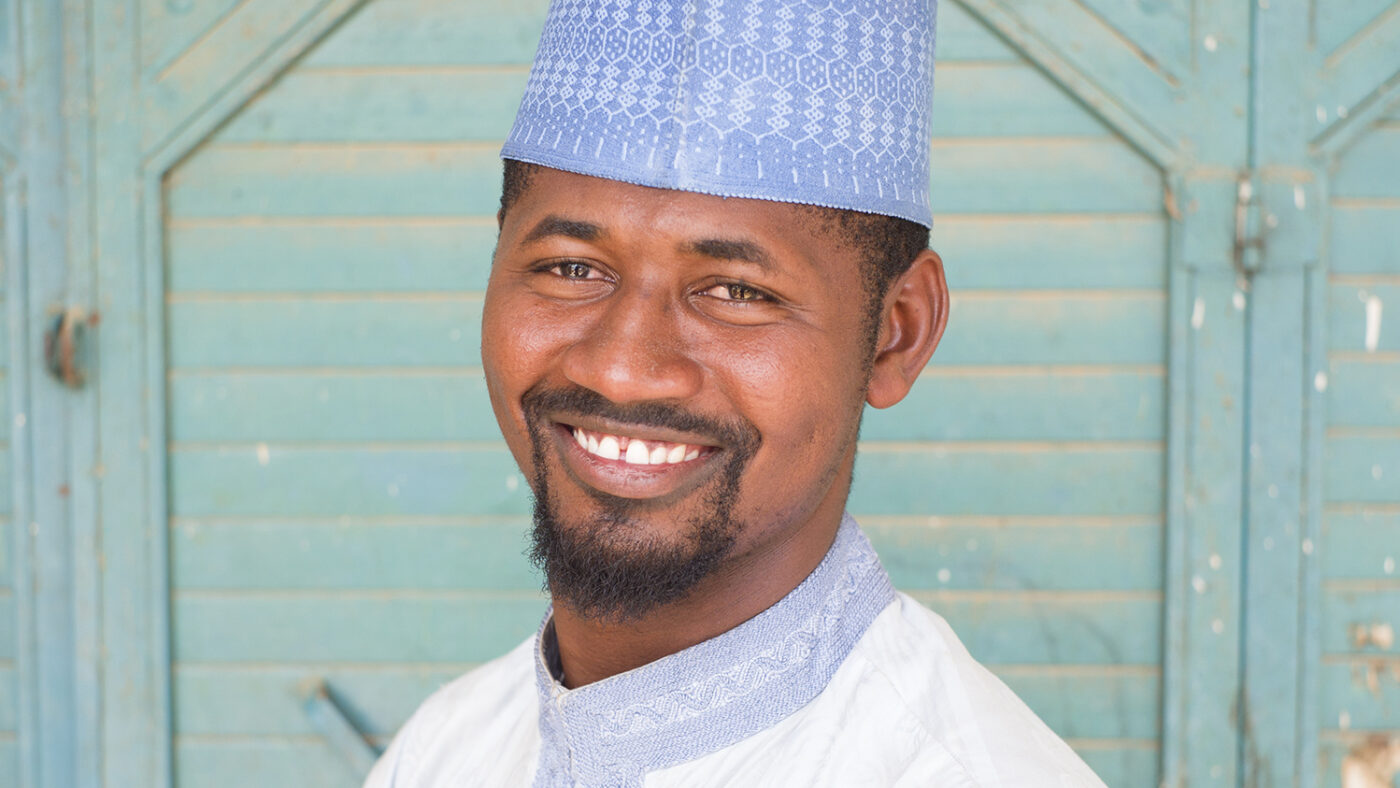 A portrait of Mubarak Mohammed, a community volunteer from Nigeria.