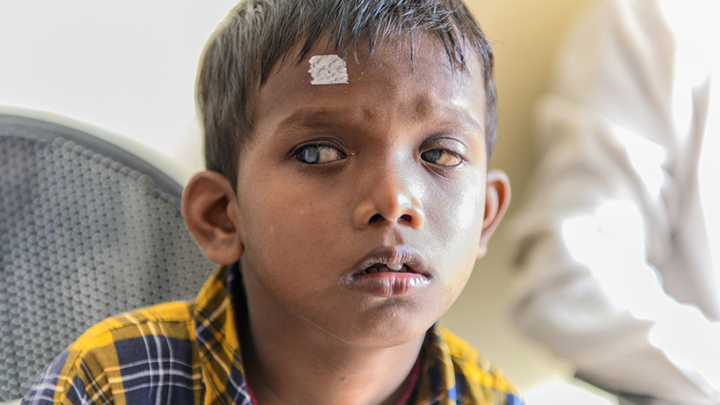 Sanjit sitting in the eye hospital after having his cataract examined.