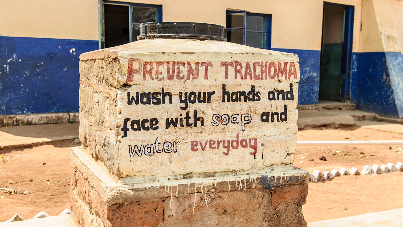 A sign telling people to wash their hands and face with soap to prevent trachoma.