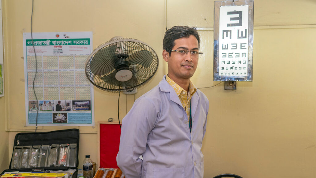 A man standing in an eye testing room.