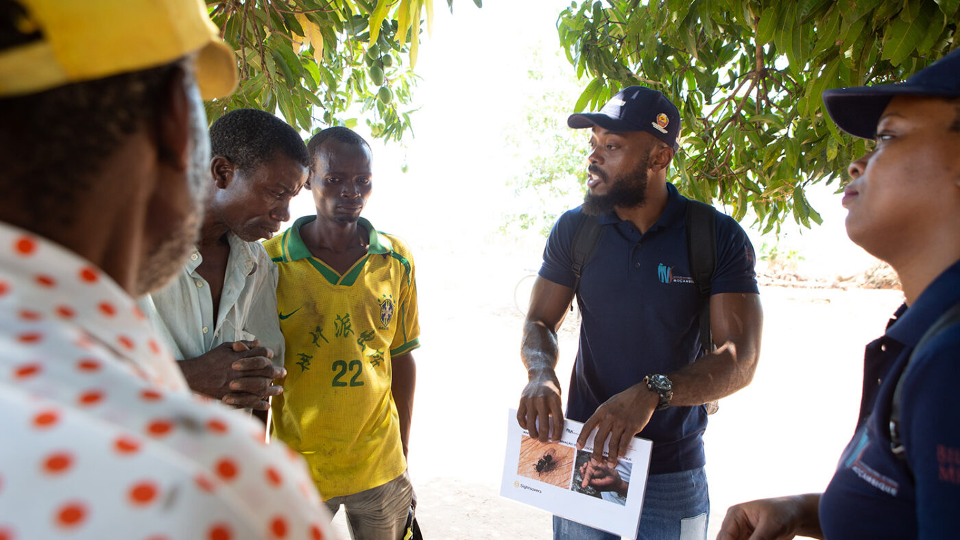 A man shares information about river blindness with a group of people.