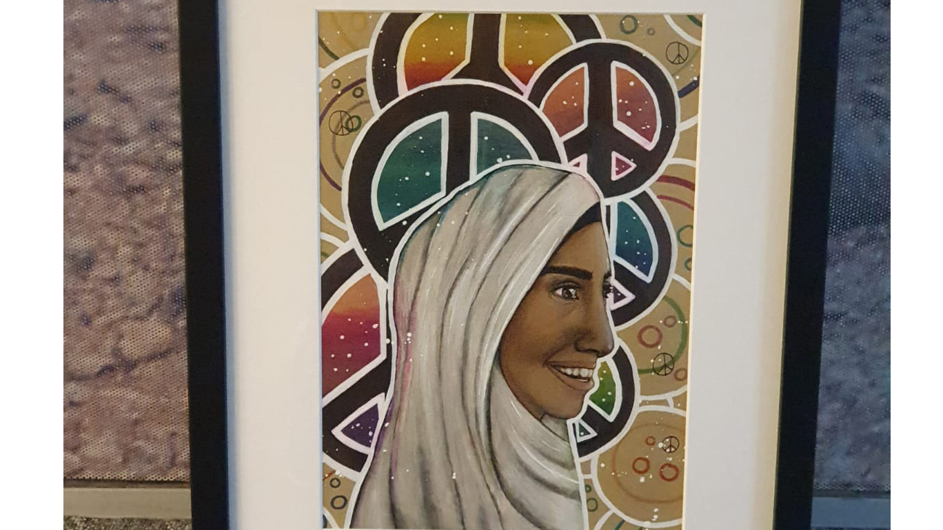 A painting of a woman in a hijab with peace symbols in the background.