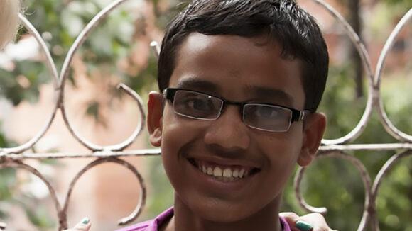 A teenage boy smiling.