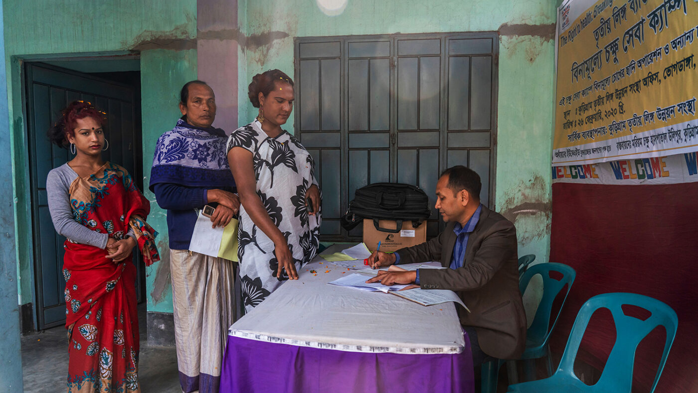 Women at registration desk of a eye health screening camp.