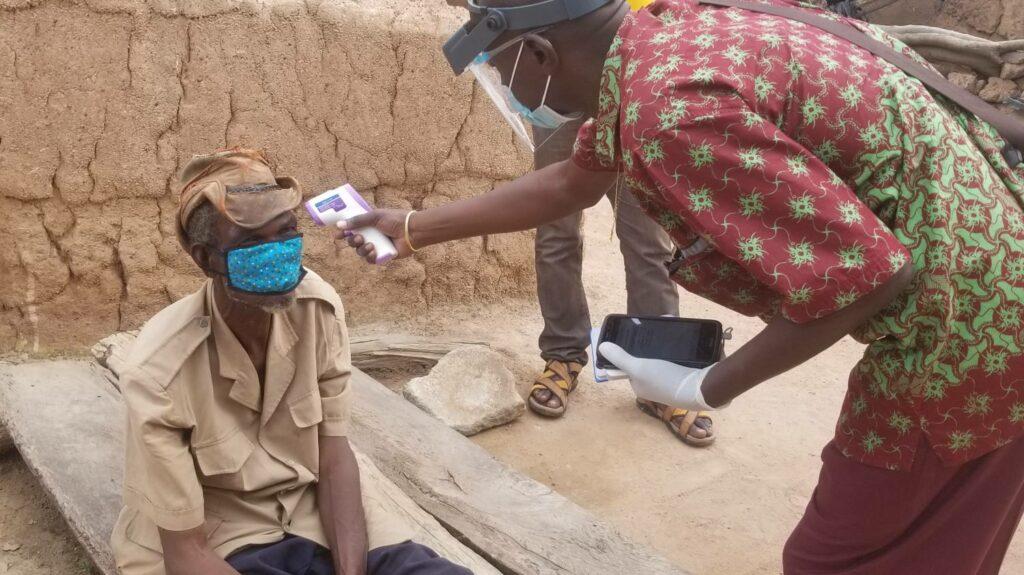 Investigator taking patient temperature before examination for trachoma