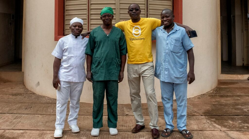 Surgical team standing together outside the clinic