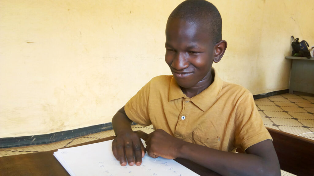 A student using braille.