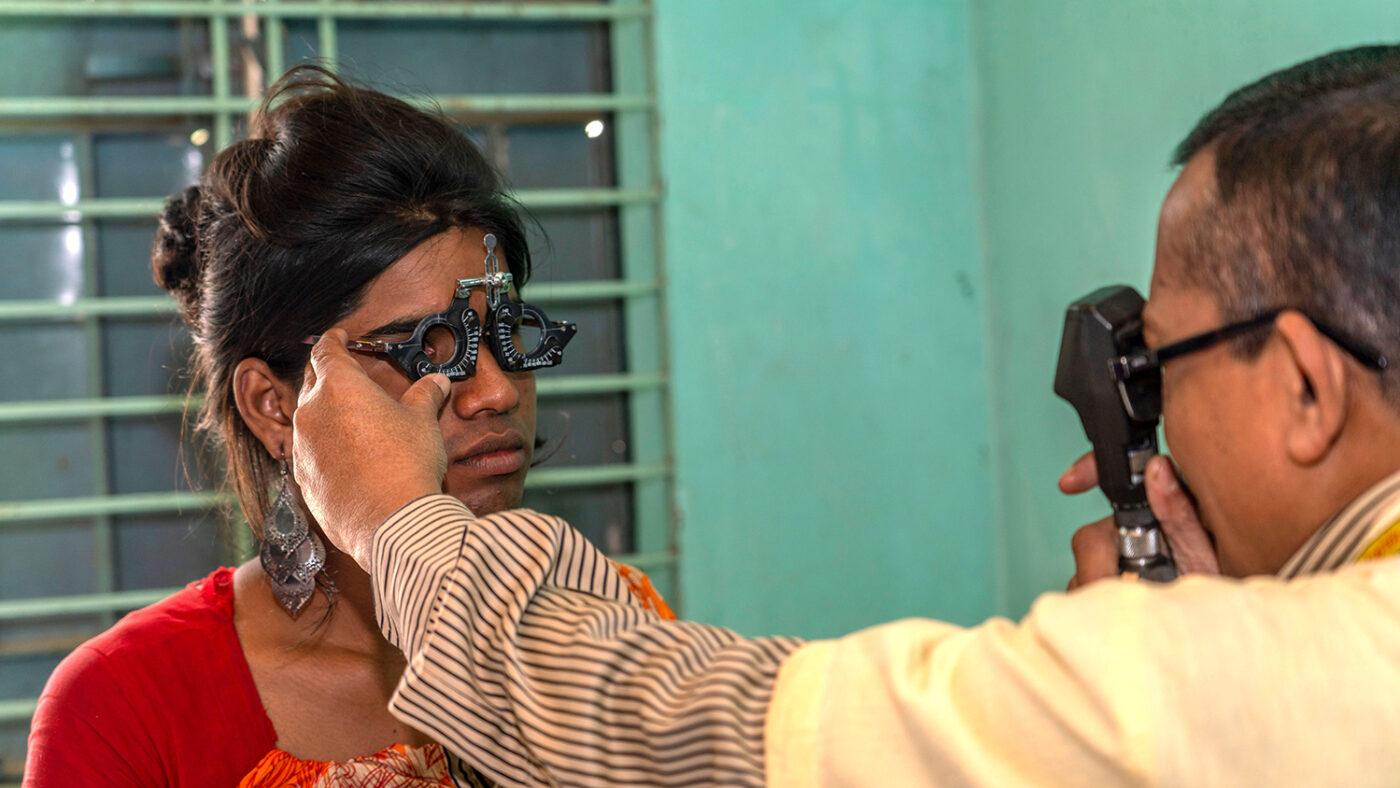 Women having sight tested.