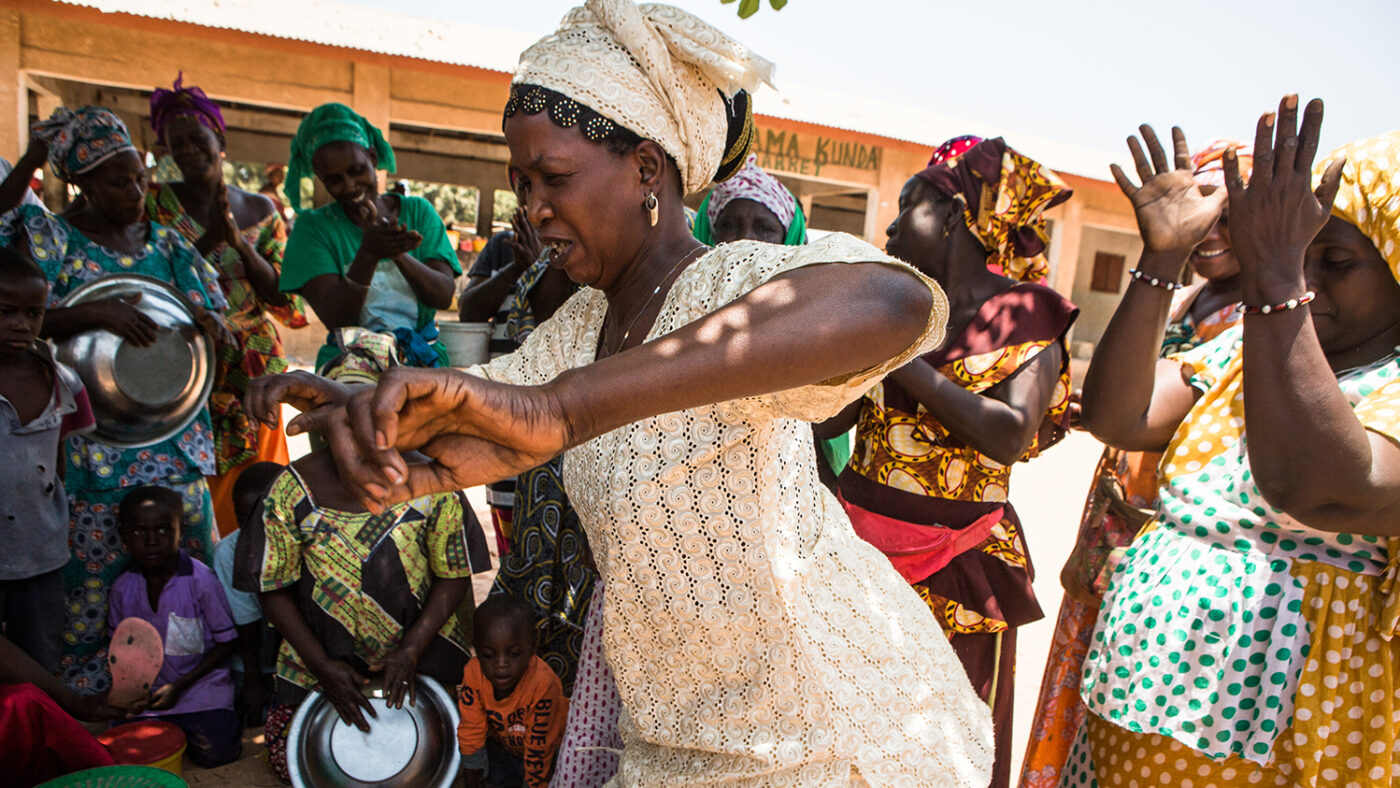 A group of women sing songs and dance to raise awareness about trachoma.