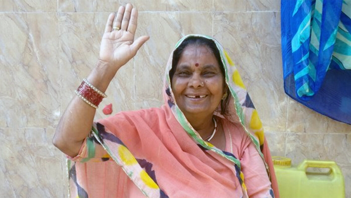 Bhanwar waves at the camera after her cataract surgery.