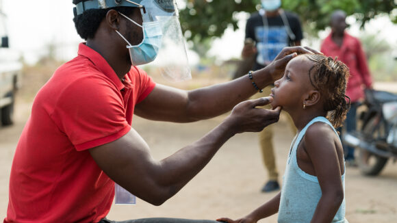 A trachoma grader looks at a child's eyes to check for signs of the disease.
