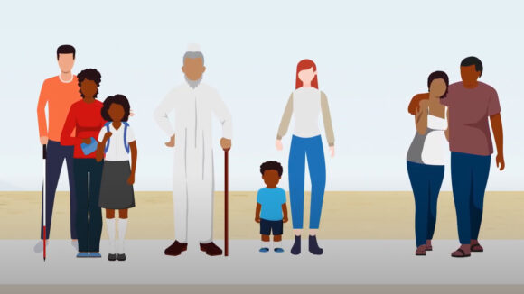 A still from Sightsavers health systems video, showing a group of people standing in a line: a family, an older man with a cane, a mother and child, and a couple.