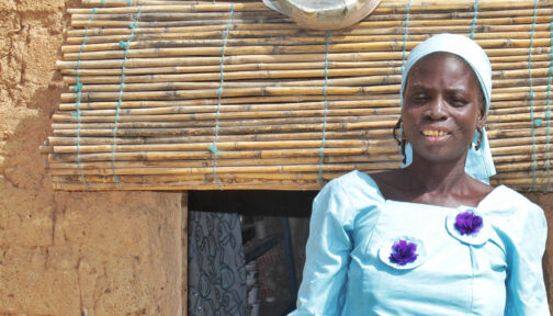Zuwaira suffers with trichiasis, she's stood outside her home in the glaring sunlight.