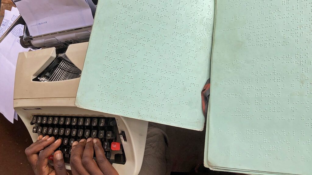 A close-up of pages from a braille school book.
