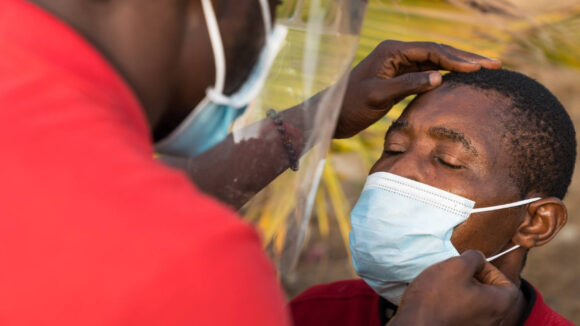 A man has his eyes checked for signs of trachoma.