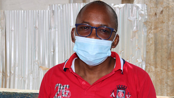 Dr Coulibaly wearing a mask and looking at the camera.